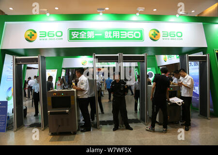 --FILE--Security staffs are seen at the stand of Qihoo (360.cn) during the 15th China Internet Conference in Beijing, China, 21 June 2016.   Qihoo 360 - Stock Photo