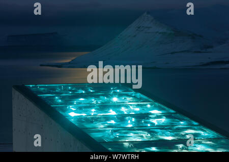 Svalbard Global Seed Vault, with glittering facade designed by artist Dyveke Sanne., on the roof of the Svalbard Global Seed Vault. Light reflected in steel, mirrors, and prisms in landscape, Svalbard, Norway, October 2012. - Stock Photo