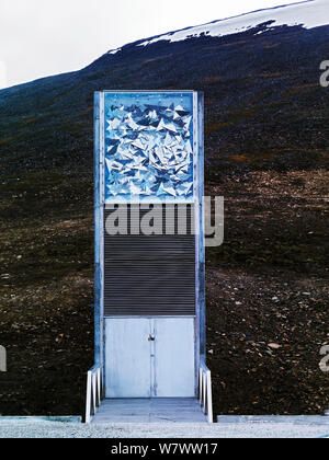 Svalbard Global Seed Vault entrance with glittering facade designed by artist Dyveke Sanne. Light reflected in steel, mirrors, and prisms in landscape, Svalbard, Norway, October 2012. - Stock Photo