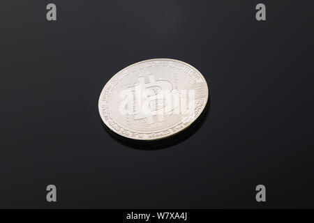silver bitcoin on black background, cryptocurrency image, copy space - Stock Photo