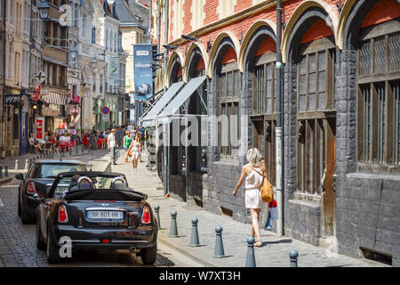 Lille, France - July 20, 2013. Woman shopping on Rue de la Monnaie outside Musee Hospice Comtesse, the Old Hospital, in the old historic centre of Lil - Stock Photo