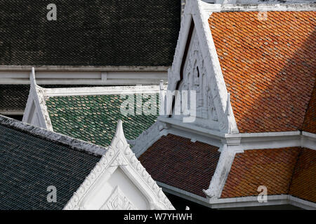 Roofs seen from the upper steps of the Golden Buddha (Sukhothai Traimit) temple in Bangkok. Thailand, September 2014.