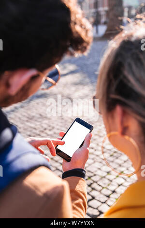 Picture of young couple using phone to find way - Stock Photo