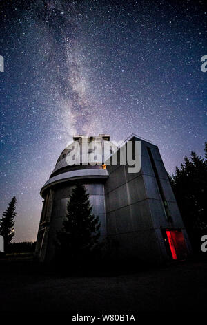 Milky way galaxy over observatory - Stock Photo