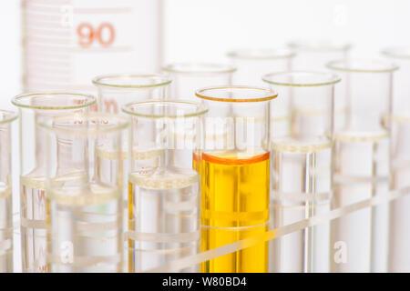 scientific experiment in chemical laboratory - Stock Photo