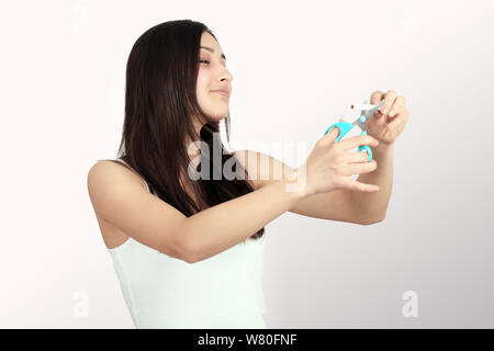 Stop Smoking Cigarettes Concept. Portrait Of Beautiful Smiling Woman Holding Broken Cigarette In Hands. Happy Female Quitting Smoking Cigarettes. Quit - Stock Photo