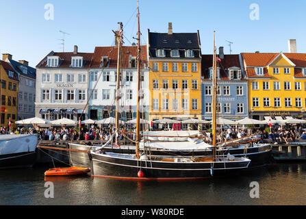 Copenhagen travel - colourful boats and buildings in Nyhavn canal, with blue sky, Copenhagen city center, Copenhagen Denmark Scandinavia Europe