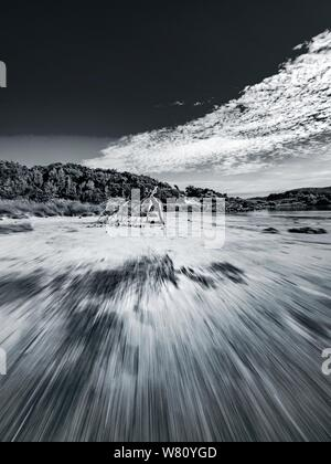 Sandy beach vacated vacant countryside speeding low view along Black and White B&W monochrome retro - Stock Photo