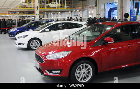 Cars are on display during the offline ceremony of All New Focus, in Harbin city, northeast China's Heilongjiang province, 22 February 2017.   The fir - Stock Photo