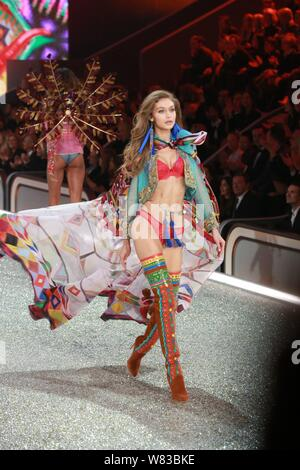 American model Gigi Hadid displays a new creation during the 2016 Victoria's Secret Fashion Show in Paris, France, 30 November 2016. - Stock Photo