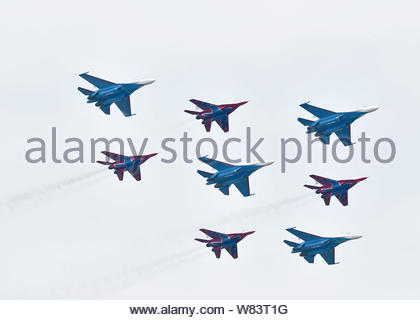 Sukhoi Su-27 fighter jets of 'The Russian Knights' aerobatic team, blue, and Mig-29 fighter jets of 'The Swifts' aerobatic team perform during the 11t - Stock Photo