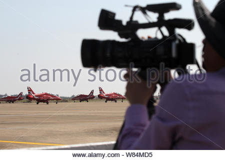HAWK jet planes of the Red Arrow, officially known as the Royal Air Force Aerobatic Team, are pictured in Zhuhai city, south China's Guangdong provinc - Stock Photo