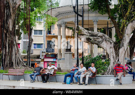 Scene of daily life in Park Santa Ana, at the end of the well known and historic pedestrian avenue called 'La Peatonal' or 'La Central' in Panama City - Stock Photo