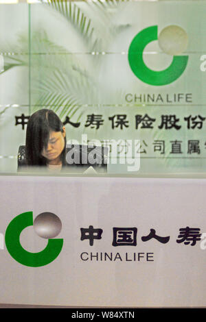--FILE--A Chinese employee works at a branch of China Life Insurance Company in Shanghai, China, 11 April 2010.   Starwood Capital Group sold a stake - Stock Photo