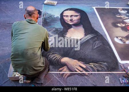 Florence, Italy - April 23, 2017 - Street artist paints the Mona Lisa using chaulk - Stock Photo