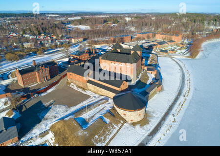 Aerial view of the ancient fortress of the Hameenlinna sity on a sunny March day (aerial photography). Finland - Stock Photo