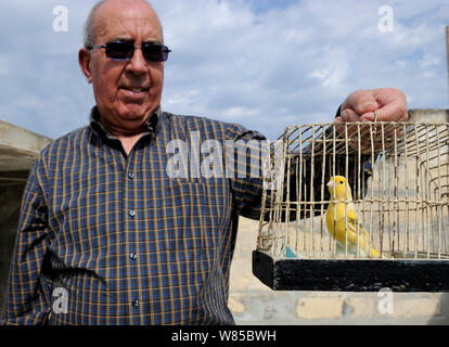 Albert Dimech, with pet Canary (Serinus canaria) Malta, March 2012. - Stock Photo
