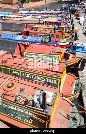 Moored canal boats on The Worcester and Birmingham Canal, Gas Street Basin, Birmingham, West Midlands, England, United Kingdom - Stock Photo
