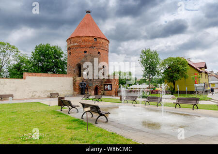 Dobre Miasto, ger. Guttstadt, warmian-mazurian province, Poland. The gothic Stork Tower, remains of the medieval city walls. - Stock Photo