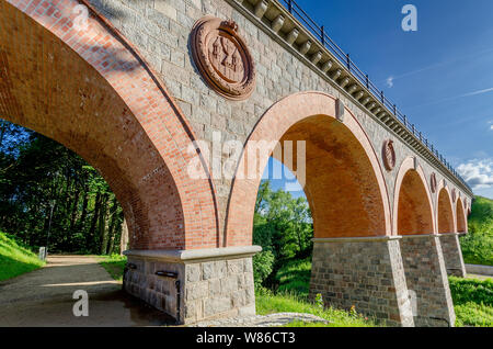 Bytow, pomeranian province, Poland, ger.: Butow. Historic 19th cent. railway bridge over the river of  Boruja. - Stock Photo