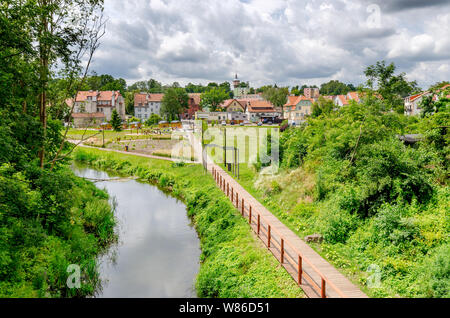 Dobre Miasto, ger. Guttstadt, warmian-mazurian province, Poland. Town panorama by the riverbank of Lyna (ger. Alle). - Stock Photo