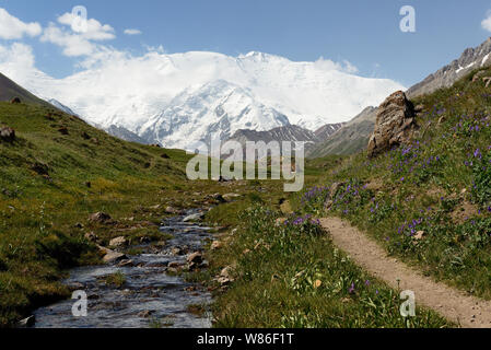 The beautiful Pamir mountains, trekking destination. View on the Lenin Peak, Kyrgyzstan, Central Asia. - Stock Photo