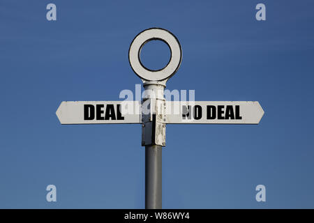 Old road sign with deal and no deal on opposite sides.  Brexit concept. - Stock Photo
