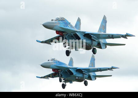 Two Ukrainian Air Force Sukhoi SU-27 Flanker at RIAT 2019 at RAF Fairford, Gloucestershire, UK - Stock Photo