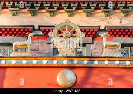 Dharmacakra - Wheel of the Dharma and two doe simbol of buddhism, hinduism, jainism. Datsan Gunzechoinei large Buddhist temple. - Stock Photo