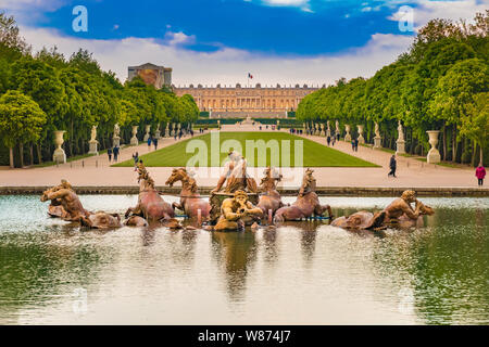 Great view of the Apollo Fountain (Bassin d'Apollon) in the classic French formal garden with the green carpet (Tapis Vert), the Latona Fountain... - Stock Photo