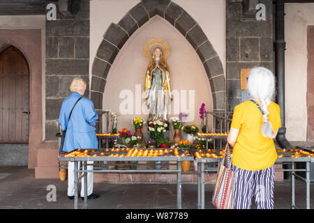 statue of Madonna in replica of the Grotto of Lourdes at Liebfrauen church, Frankfurt am Main, Germany - Stock Photo