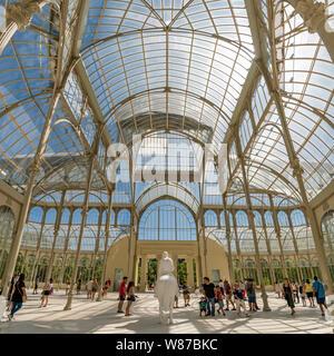Square panoramic of the Palacio de Cristal at Retiro Park in Madrid.