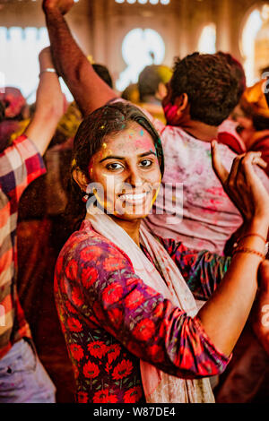 Barsana, India - February 23, 2018 - A young woman dances with joy during Holi festival - Stock Photo