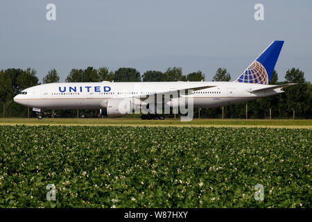 AMSTERDAM / NETHERLANDS - JULY 3, 2017: United Airlines Boeing 777-200 N78003 passenger plane taxiing at Amsterdam Schipol Airport - Stock Photo