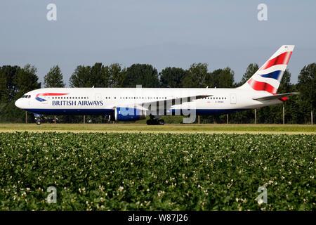 AMSTERDAM / NETHERLANDS - JULY 3, 2017: British Airways Boeing 767-300 G-BNWB passenger plane taxiing at Amsterdam Schipol Airport - Stock Photo