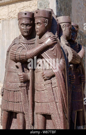 Sculpture 'Portrait of the four Tetrarchs' on corner of St Mark's Basilica, Venice, Italy - Stock Photo