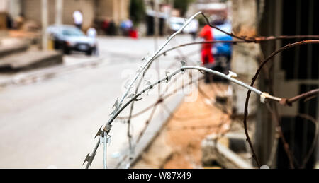 Close up of Razor Barb Wire on a fence in Urban South African Township - Stock Photo