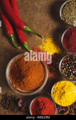 Red hot chili peppers. Place for text. Different types of Spices in a bowl on a stone background. The view from the top - Stock Photo