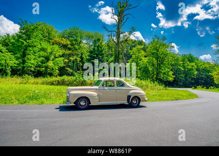 Classic 1947 Ford stopped on an overlook area on the skyline drive in the Skyline Drive Scenic Highway in Shenandoah National Park - Stock Photo