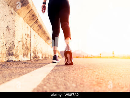 sport woman walking towards on the road side. Step concept - Stock Photo