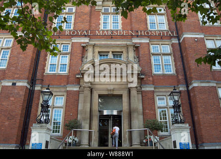 a woman approaches the entrance of the royal marsden hospital, chelsea, london, england - Stock Photo