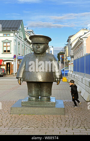 Statue of policeman Bobby on market square in center of Oulu - Stock Photo