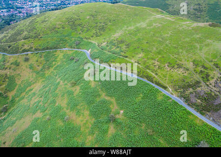 Aerial shoot over green slopes of Carding Mill Valley in Church Stretton, Shropshire, UK - Stock Photo