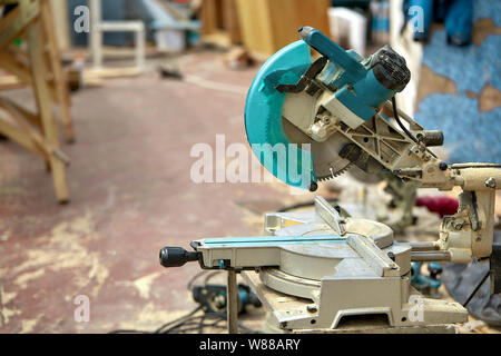 Close-up of a laser circular saw at a construction site. Products for home and garden and production. Building tool. - Stock Photo
