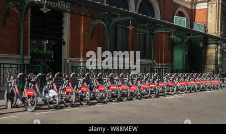 A row of Santander bicycles for hire at Covent Garden, London - Stock Photo
