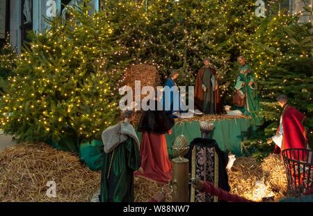 Ghent, Belgium - December 16, 2018: Nativity scene exhibit figures representing the birth of Jesus at Christmas season in Saint Bavo Cathedral. - Stock Photo