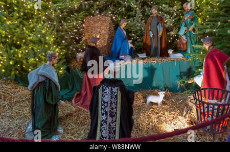 Ghent, Belgium - December 16, 2018: Nativity scene exhibit figures representing the birth of Jesus at Christmas season in Saint Bavo Cathedral. - Stock Photo
