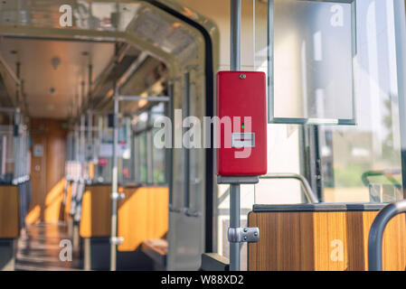 Selected focus of Red public transportation ticket stamp or validation ticket machine inside tram or train. - Stock Photo