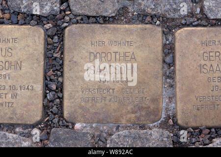 Stumbling stones in Berlin, Germany - Stock Photo