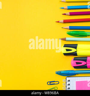 School supplies on yellow background. Top view. Copy space. - Stock Photo